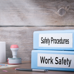 work safety and safety procedures folders on desk