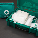 First aid box and travel kit filled with bandages, wipes and scissors