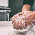Person washing hands thoroughly