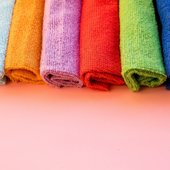 Multi-coloured microfibre cloths in a row